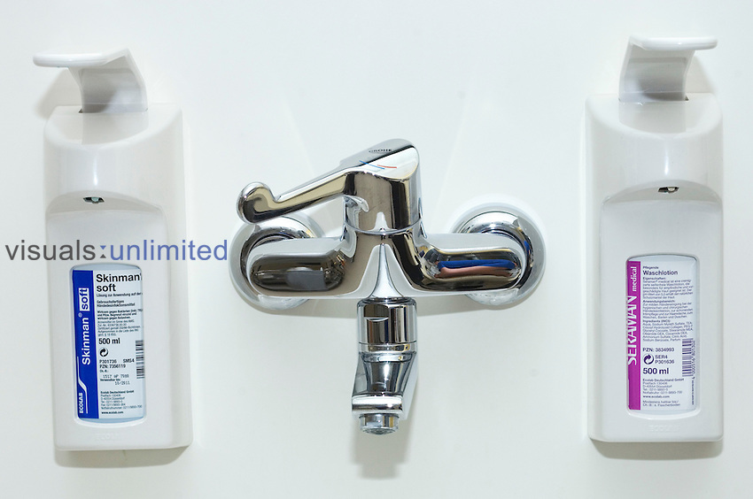 A water tap and anti-bacterial hands scrub. Royalty Free