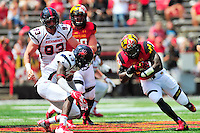 William Likely of the Terrapins lowers his head after a big gain. Maryland defeated Richmond 50-21 during home season opener at the Byrd Stadium in College Park, MD on Saturday, September 5, 2015.  Alan P. Santos/DC Sports Box
