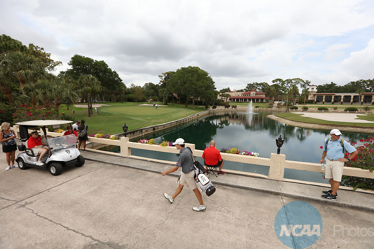 HOWEY IN THE HILLS, FL - MAY 19: Sell Graham of Guilford College walks over a bridge to the 17th green during the Division III Men's Golf Championship held at the Mission Inn Resort and Club on May 19, 2017 in Howey In The Hills, Florida. (Photo by Cy Cyr/NCAA Photos via Getty Images)