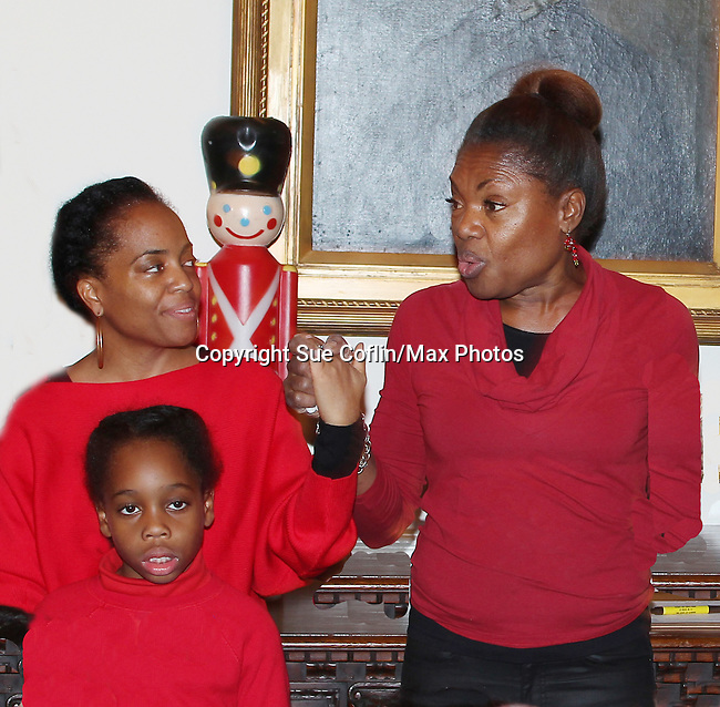 Actress and singer Rhonda Ross (Another World) and son Raif with founder Deborah Koenigsberger at Hearts of Gold links to a better life celebrates Christmas with a party #2 for mothers and their children on December 17, 2016 in New York City, New York with arts and crafts, a great turkey dinner with all the goodies and then the children met Santa Claus and had a photo with him as he gave them gifts. (Photo by Sue Coflin/Max Photos)