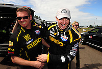Mar. 12, 2012; Gainesville, FL, USA; NHRA top fuel dragster driver Morgan Lucas celebrates with crew members after winning the Gatornationals at Auto Plus Raceway at Gainesville. The race is being completed on Monday after rain on Sunday. Mandatory Credit: Mark J. Rebilas-