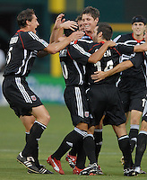 DC United midfielder Christian Gomez (10) celebrates with teammates after he scores in the 7th minute of play. Monarcas Morelia tied DC United 1-1 in  the SuperLiga opening match in group B, at RFK Stadium Washington DC, Wednesday July 25, 2007.