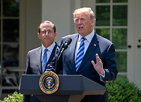 United States President Donald J. Trump announces a &quot;new blueprint&quot; for lowering prescription drug prices in the Rose Garden of the White House in Washington, DC on Friday, May 11, 2018.  US Secretary of Health and Human Services Alex Azar looks on from left.<br /> CAP/MPI/RS<br /> &copy;RS/MPI/Capital Pictures