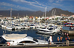 Boats and Yachts at thir moorings, Puerto Colon harbour, Playa de las Americas, Tenerife, canary Islands.