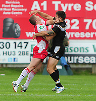 Hull FC's Tom Briscoe gets caught in the face by Hull Kingston Rovers' Travis Burns with lead to a brawl between the two teams<br /> <br />  (Photo by Chris Vaughan/CameraSport) <br /> <br /> Rugby League - Super League - Hull Kingston Rovers v Hull FC - Sunday 11th August 2013 - MS3 Craven Park - Hull<br /> <br /> © CameraSport - 43 Linden Ave. Countesthorpe. Leicester. England. LE8 5PG - Tel: +44 (0) 116 277 4147 - admin@camerasport.com - www.camerasport.com