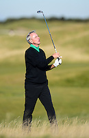 Ex-Footballer Johan Cruyff hits an approach during Round 1 of the 2015 Alfred Dunhill Links Championship at the Old Course, St Andrews, in Fife, Scotland on 1/10/15.<br /> Picture: Richard Martin-Roberts | Golffile