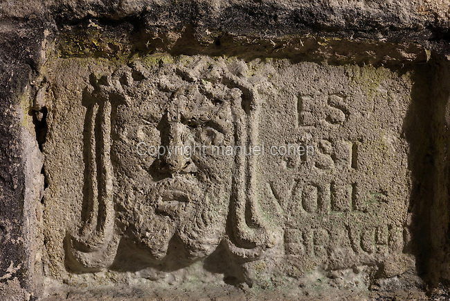 Carving of Christ with the inscription 'It is finished', made by German soldiers in the stone wall of Fort de Douaumont, built 1885-1913, the largest of the 19 defensive forts around Verdun, Meuse, Lorraine, France. In 1916, during the Battle of Verdun in World War One, the German army occupied the fort, which was only recaptured after 9 months of intense fighting and the loss of tens of thousands of men, ending in the First Offensive Battle of Verdun on 24 October 1916. Picture by Manuel Cohen
