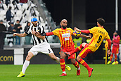 5th November 2017, Allianz Stadium, Turin, Italy; Serie A football, Juventus versus Benevento; Samuel Armenteros and Danilo Cataldi shield the ball from Giorgio Chiellini