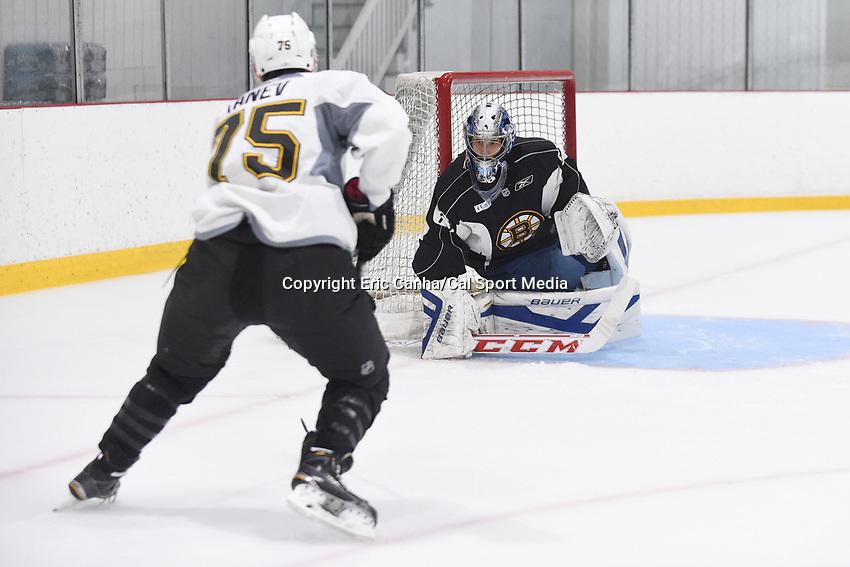 July 15, 2015 - Wilmington, Massachusetts, U.S. - Goalie Daniel Vladar (70) and forward Brandon Tanev (75) take part in the Boston Bruins development camp held at Ristuccia Arena in Wilmington Massachusetts. Eric Canha/CSM