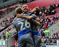 Lincoln City's Harry Anderson, left, celebrates scoring his side's second goal with team-mates Jack Payne, centre, and Jorge Grant<br /> <br /> Photographer Chris Vaughan/CameraSport<br /> <br /> The EFL Sky Bet Championship - Rotherham United v Lincoln City - Saturday 10th August 2019 - New York Stadium - Rotherham<br /> <br /> World Copyright © 2019 CameraSport. All rights reserved. 43 Linden Ave. Countesthorpe. Leicester. England. LE8 5PG - Tel: +44 (0) 116 277 4147 - admin@camerasport.com - www.camerasport.com
