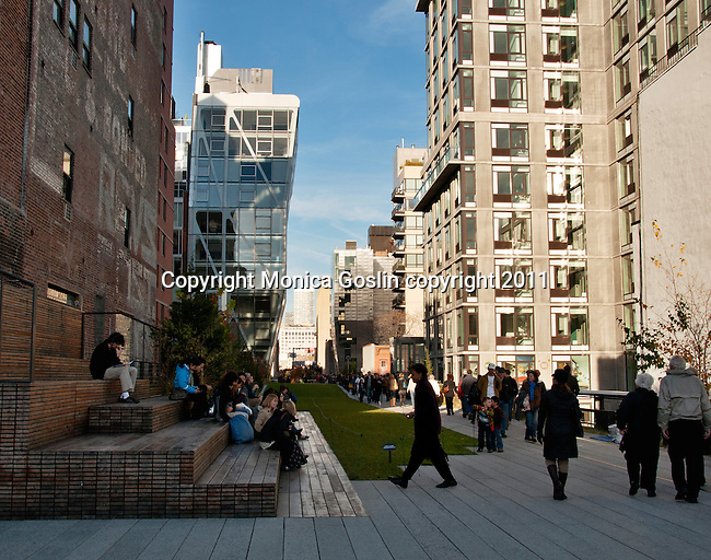 People walking on the Highline, a public park on an old elevated train line, in New York City