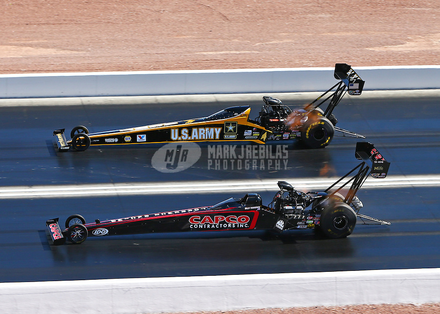 Nov 2, 2014; Las Vegas, NV, USA; NHRA top fuel driver Billy Torrence (near) defeats Tony Schumacher in the first round during the Toyota Nationals at The Strip at Las Vegas Motor Speedway. Mandatory Credit: Mark J. Rebilas-USA TODAY Sports