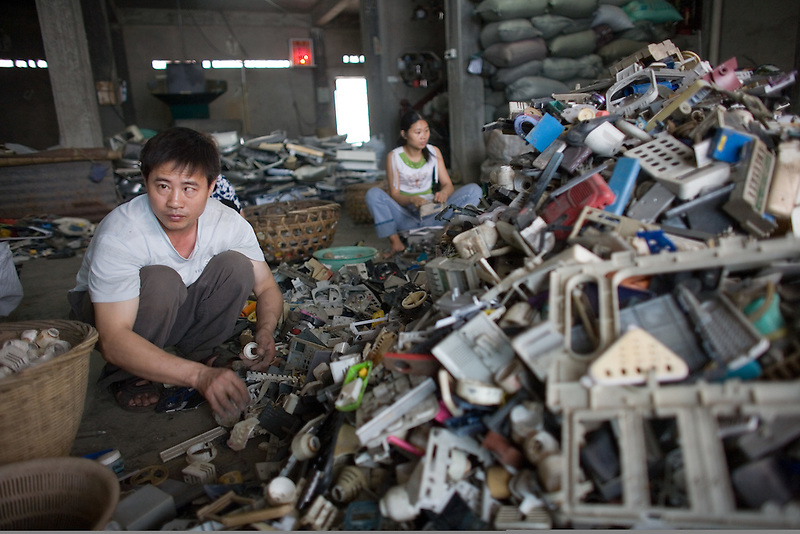 Migrant workers sort plastics in a junk yard that processes electronic trash in Guiyu in southern China's Guangdong province.  Each year, between 20 and 50 million tons of electronic waste is generated globally. Most of it winds up in the developing world. Some of the most popular destinations for dumping computer hardware include China, India, and Nigeria. It can be 10 times cheaper to ship waste to China than to dispose of it properly at home. With the market for e-waste expected to top $11 billion by 2009, it's lucrative to dump on the developing world.