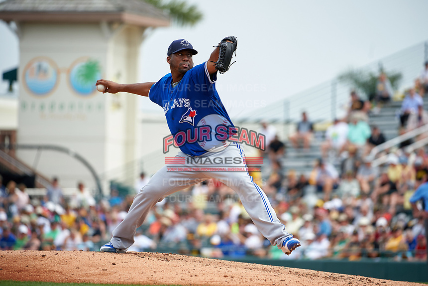 Toronto Blue Jays pitcher Roberto Hernandez (56) delivers a pitch during a Spring Training game against the Pittsburgh Pirates on March 3, 2016 at McKechnie Field in Bradenton, Florida.  Toronto defeated Pittsburgh 10-8.  (Mike Janes/Four Seam Images)