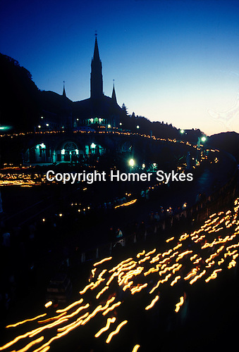 Lourdes night candel lit procession France.
