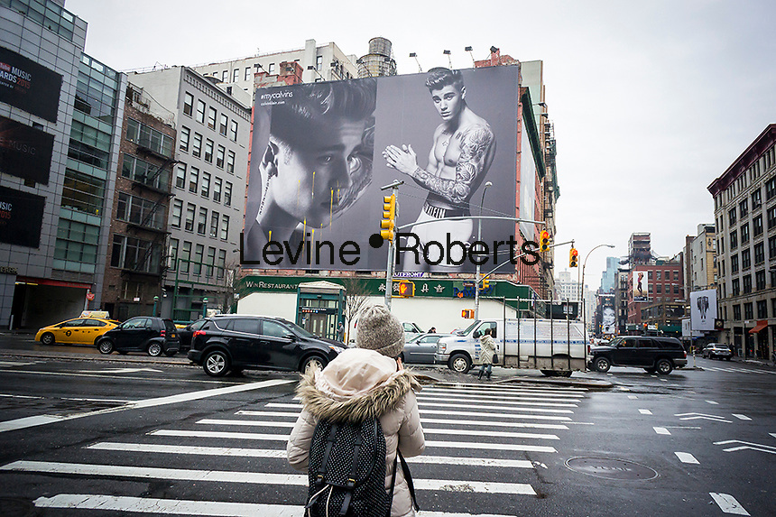 A Calvin Klein underwear billboard in the Soho neighborhood of New York features model/musician Justin Bieber on Wednesday, March 4, 2015, 2015. The ads featuring Bieber, the new face of the brand, are imitating the iconic Mark Wahlberg Calvin Klein advertisements from the early 1990's. A non-fan of either Bieber or Klein has splattered the ad with yellow paintball.. (© Richard B. Levine)