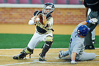 Wake Forest Demon Deacons catcher Charlie Morgan #26 reaches for a throw as Ian Graham #8 of the UNC-Asheville Bulldogs slides across home plate at Wake Forest Baseball Park on February 28, 2012 in Winston-Salem, North Carolina.  The Demon Deacons defeated the Bulldogs 9-8.  (Brian Westerholt/Four Seam Images)
