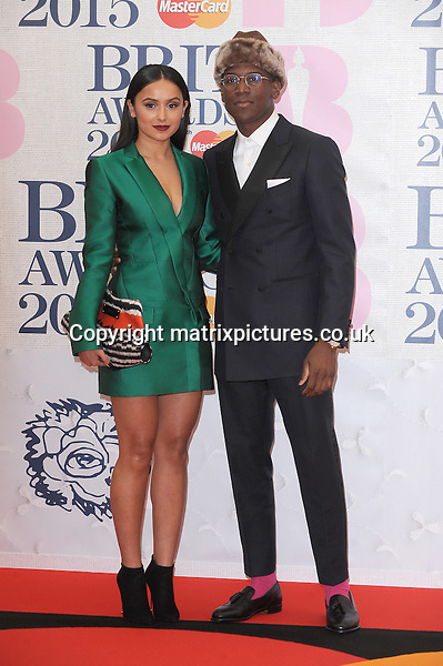 NON EXCLUSIVE PICTURE: PAUL TREADWAY / MATRIXPICTURES.CO.UK<br /> PLEASE CREDIT ALL USES<br /> <br /> WORLD RIGHTS<br /> <br /> English singer-songwriter Labrinth and Muz attending the BRIT Awards 2015 at the O2 Arena, in London.<br /> <br /> FEBRUARY 25th 2015<br /> <br /> REF: PTY 15627