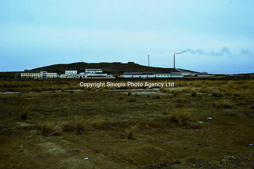 "A ""rare-earth"" processing plant near Bayon Obo, Inner Mongolia.  The plant conducts first stage processing in extremely toxic conditions where workers complain of acid burns and sores as well as head-aches. The production of ""rare-earths"" is an extremely poisenous process with plants in the U.S. being closed due to environmental concerns. China accounts for some 97% of rare earth consumed world-wide. The ""rare earth elements"" are a group of 17 elements that are essential in 25% of modern technology including cell phones, computer hard discs, and electric motors and inparticular green technology such as electric batteries and wind turbines."