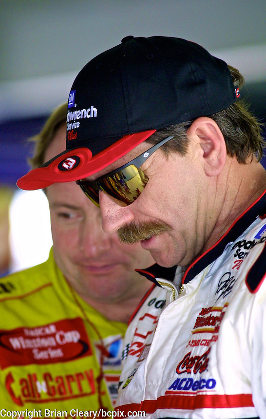 Dale Earnhardt and Ken Schrader are shown during practice for the Daytona 500, Daytona International Speedway, Daytona Beach, FL, February, 2001.  (Photo by Brian Cleary/www.bcpix.com)