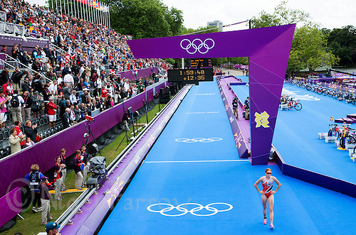 04 AUG 2012 - LONDON, GBR - Paula Findlay (CAN) of Canada recovers after finishing the women's London 2012 Olympic Games Triathlon in Hyde Park, London, Great Britain .(PHOTO (C) 2012 NIGEL FARROW)