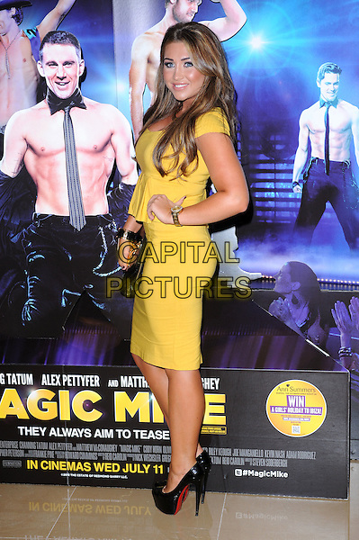 Lauren Goodger.'Magic Mike' UK Premiere, May Fair Hotel, London, England..July 10th, 2012.full length yellow peplum dress black hand on hip clutch bag side .CAP/BEL.©Tom Belcher/Capital Pictures.