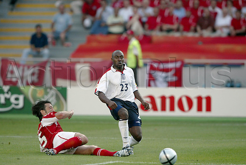 17 June 2004: England striker DARIUS VASSELL takes a shot at goal during the Euro 2004 Group B game between England and Switzerland played at the Estadio Cidade de Coimbra, Coimbra, Portugal. England won the game 3-0. Photo: Neil Tingle/Action Plus...040617 football soccer player players UEFA European Championships
