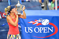 NEW YORK, USA - SEPT 10, Angelique Kerber of Germany kisses her trophy after defeating Karolina Pliskova of Czech Republic during their Women's Singles Final Match of the 2016 US Open at the USTA Billie Jean King National Tennis Center on September 10, 2016 in New York.  photo by VIEWpress