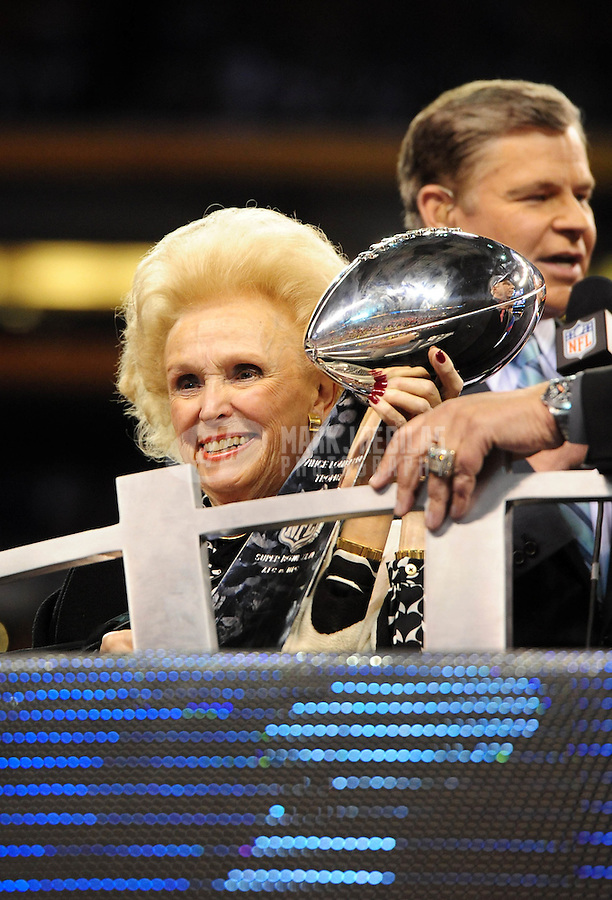 Feb 5, 2012; Indianapolis, IN, USA; Mother of the New York Giants president and CEO John Mara (not pictured), Ann Mara, holds the Vince Lombardi Trophy after Super Bowl XLVI against the New England Patriots at Lucas Oil Stadium. Giants won 21-17. Mandatory Credit: Mark J. Rebilas-.