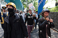 Yuhimaru Takeda (right) protesting at a Zengakuren student union demo at Hosei University Campus. Ichigaya, Tokyo, Japan. Friday April 25th 2014