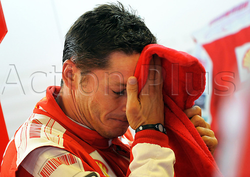 Italian Formula One driver Giancarlo Fisichella of Scuderia Ferrari wipes off the sweat in the pits during the first practice session at Parco di Monza racetrack in Monza, Italy, 11 September 2009. The Formula 1 Grand Prix of Italy will be held on 13 September 2009. Photo: Peter Steffen/Actionplus. UK Licenses Only