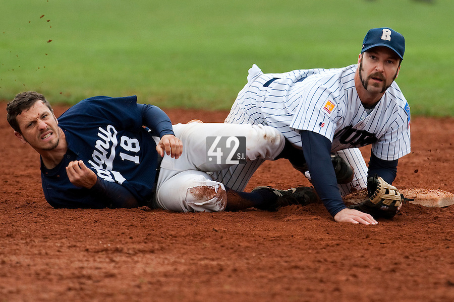 10 october 2009: Dany Scalabrini of Rouen falls as he throws the ball to first base for the double play over Chris Goniot of Savigny during game 4 of the 2009 French Elite Finals won 7-2 by Huskies of Rouen over Lions of Savigny, at Stade Jean Moulin stadium in Savigny sur Orge, near Paris, France. Rouen wins the 2009 France championship, his sixth title.