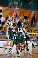 11 November 2011:  FIU's Diamond Ashmore (13) puts up a shot over Jacksonville's Chelsea Faulhaber (44) in the second half as the FIU Golden Panthers defeated the Jacksonville University Dolphins, 63-37, at the U.S. Century Bank Arena in Miami, Florida.