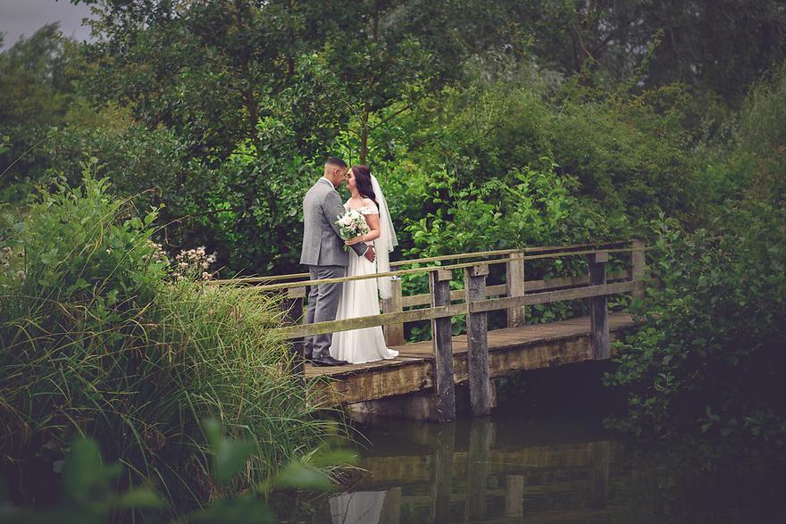 Bride and Groom on Rustic Bridge at Three Lakes, Westmill Farm