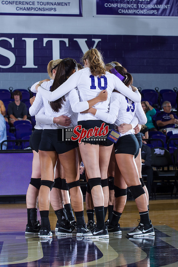 The High Point Panthers huddle up during their match against the VCU Rams at Millis Athletic Center on September 17, 2013 in High Point, North Carolina.  The Rams defeated the Panthers 3-0.   (Brian Westerholt/Sports On Film)