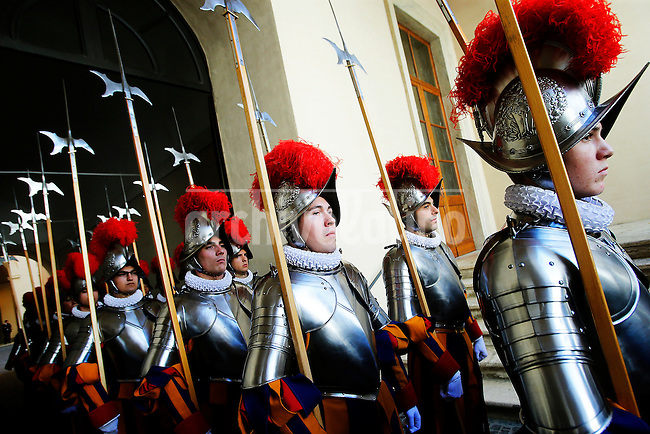 New Swiss Guard recruits stand to attend a swearing-in ceremony in San Damaso square at the Vatican on May 6, 2014