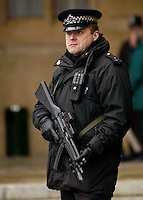 Police gun guard security outside House of Commons, Houses of Parliament, Westminster, London, UK
