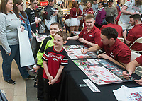 NWA Democrat-Gazette/BEN GOFF @NWABENGOFF<br /> Logan Bates (left) and friend Bentley Burch, both 7, of Clinton pose for pictues while getting autographs from Arkansas players Saturday, Feb. 9, 2019, during Arkansas baseball's annual Meet the Razorbacks Day at Northwest Arkansas Mall in Fayetteville.