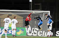 Steve Cronin defends the goal against Arturo Alvarez (10) and Cam Weaver (17). San Jose Earthquakes defeated Portland Timbers 1-0 at Buck Shaw Stadium in Santa Clara, California on March 14th, 2009.