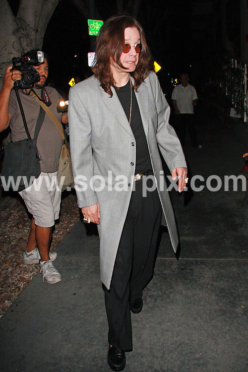 **ALL ROUND PICTURES FROM SOLARPIX.COM**.**WORLDWIDE SYNDICATION RIGHTS**.**NO PUBLICATION IN AUSTRALIA, DENMARK, GERMANY, NEW ZEALAND, OR USA**.Ozzy Osbourne and his wife Sharon have a late night dinner at madeo Restaurant in Beverly Hills in LA.  The couple is seen being playful with the paparazzi..JOB REF:7175             LAP/JSC       DATE: 03.09.08.**MUST CREDIT SOLARPIX.COM OR DOUBLE FEE WILL BE CHARGED* *UNDER NO CIRCUMSTANCES IS THIS IMAGE TO BE REPRODUCED FOR ANY ONLINE EDITION WITHOUT PRIOR PERMISSION*