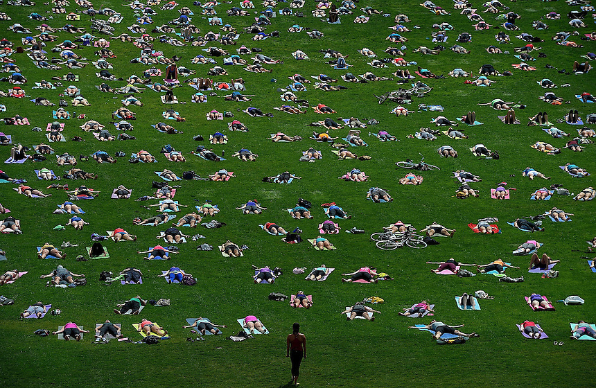 People take part in 'Yoga On The Hill' on Parliament Hill in Ottawa on Wednesday, Aug 27, 2014. THE CANADIAN PRESS/Sean Kilpatrick