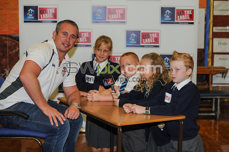 School kids 'grill' England coach as RLWC2013 announces new major sponsor<br /> A class of pupils at Christchurch C of E School IN Warrington will be given exclusive access to pose questions to England coach Steve McNamara, as Rugby League World Cup 2013 celebrates the announcement of a new major sponsor for the tournament.<br /> Picture shows Steve McNamara with Jack kirkham aged 8,Tyler Porrett aged 10,Kelsay Hazelhurst aged 10 and Aimee Wilson aged 8 who asked Steve Questions<br /> Picture by Paul Currie/SWPIX