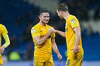 Alan Browne of Preston North End celebrates his side's win with Paul Huntington at full time of the Sky Bet Championship match between Cardiff City and Preston North End at the Cardiff City Stadium, Cardiff, Wales on 29 December 2017. Photo by Mark  Hawkins / PRiME Media Images.