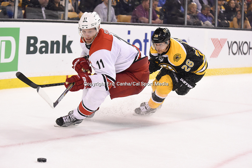 Thursday, March 10, 2016: Carolina Hurricanes center Jordan Staal (11) and Boston Bruins defenseman John-Michael Liles (26) chase the puck during the National Hockey League game between the Carolina Hurricanes and the Boston Bruins held at TD Garden, in Boston, Massachusetts. Carolina beats Boston 3-2 in overtime. Eric Canha/CSM