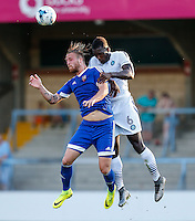 Aaron Pierre of Wycombe Wanderers (right) and Philipp Hofmann of Brentford (left) during the Friendly match between Wycombe Wanderers and Brentford at Adams Park, High Wycombe, England on 19 July 2016. Photo by David Horn PRiME Media Images.