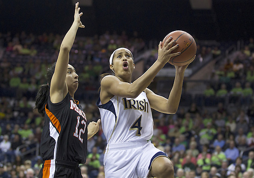 November 20, 2012:  Notre Dame guard Skylar Diggins (4) goes up for a shot as Mercer guard Jessica Prieto (12) defends during NCAA Women's Basketball game action between the Notre Dame Fighting Irish and the Mercer Bears at Purcell Pavilion at the Joyce Center in South Bend, Indiana.  Notre Dame defeated Mercer 93-36.