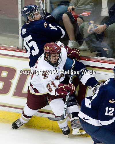 Bryce Swan (StFX - 15), Steven Whitney (BC - 21) - The Boston College Eagles defeated the St. Francis Xavier University X-Men 4-1 in their exhibition match on Sunday, October 4, 2009, at Conte Forum in Chestnut Hill, Massachusetts.