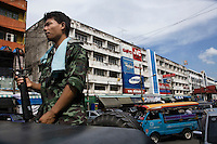 A thai army soldier stands on top of his Humwee armoured truck in center Yala, concidered one of the most dangerous of the three provinces.<br /> Thailand is struggling to keep up appearances as the land of smiles has to face up to its troubled south. Since 2004 more than 3500 people have been killed and 4000 wounded in a war we never hear about. In the early hours of January 4th 2004 more than 50 armed men stormed a army weapons depot in Narathiwat taking assault rifles, machine guns, rocket launchers, pistols, rocket-propelled grenades and other ammunition. Arsonists simultaneously attacked 20 schools and three police posts elsewhere in Narathiwat. The raid marked the start of the deadliest period of armed conflict in the century-long insurgency. Despite some 30,000 Thai troops being deployed in the region, the shootings, grenade attacks and car bombings happen almost daily, with 90 per cent of those killed being civilians. 19.09.07, Photo: Christopher Olss&oslash;n.