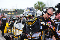 Mar. 12, 2012; Gainesville, FL, USA; NHRA top fuel dragster driver Tony Schumacher is helped with safety gear by a crew member during the Gatornationals at Auto Plus Raceway at Gainesville. The race is being completed on Monday after rain on Sunday. Mandatory Credit: Mark J. Rebilas-