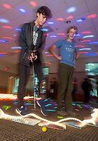 NWA Democrat-Gazette/BEN GOFF @NWABENGOFF<br /> Leo Hill (left), 12, and Daniel Schwammlein, 13, both of Fayetteville, play one of the holes Friday, Nov. 30, 2018, during teen mini golf night at the Fayetteville Public Library. Staff from each department at the library designed and built each hole with a unique theme. Staff counted fifty children and teens in attendance at the event.